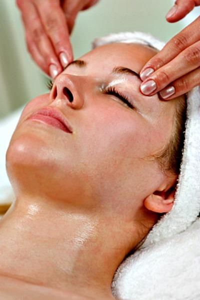Woman Enjoying A Facial At The Spa
