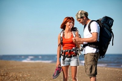Couple Getting Ready For Their Beach Hike